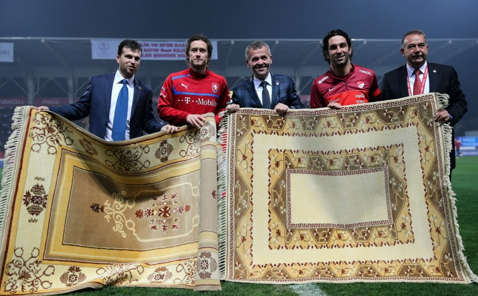 Carpet football: Rosicky, second left, and Turkish counterpart Arda Turan, second right, exchange top-drawer rugs (Picture: Spdn/Seskimphoto)