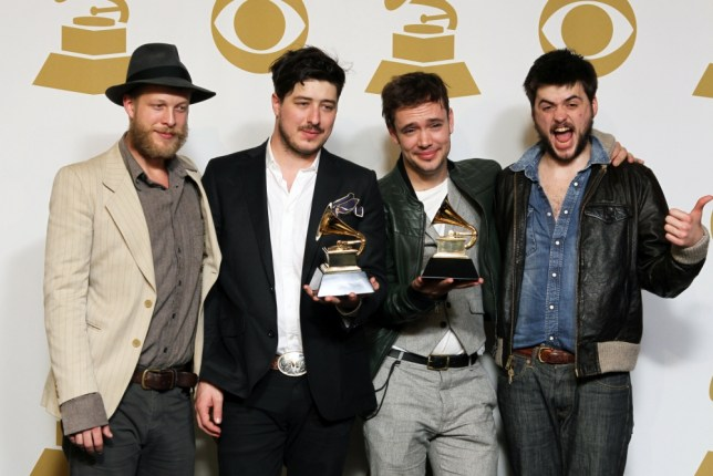"Members of the musical group Mumford &Sons, from left, Ted Dwane, Marcus Mumford, Ben Lovett and Winston Marshall, pose backstage with the best long form music video award for ""Big Easy Express"" and the album of the year award for ""Babel"" at the 55th annual Grammy Awards on Sunday, Feb."
