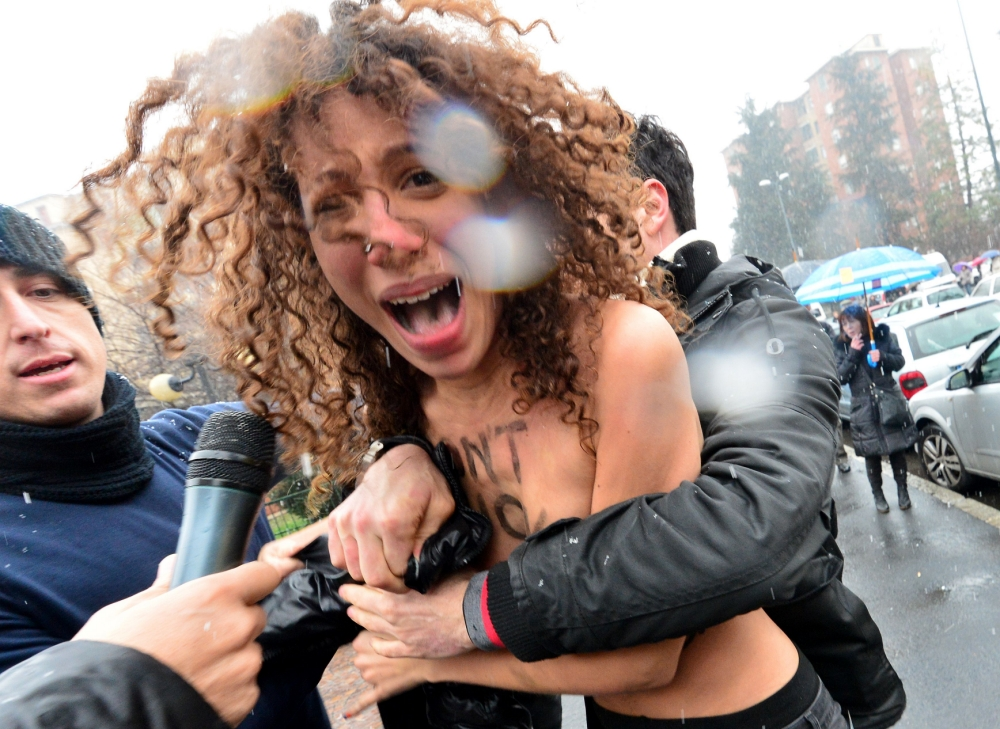 Three women arrested for topless protest against Silvio Berlusconi as Italy votes for next government