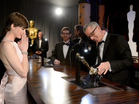Emotional Anne Hathaway holds back the tears as she gets her Best Actress Oscar engraved