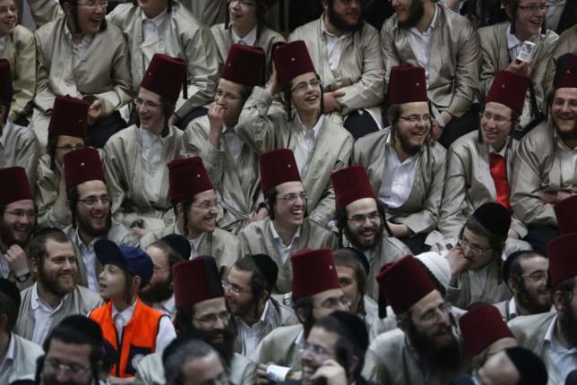 Ultra-Orthodox Jewish men celebrate the holiday of Purim in Jerusalem (Reuters)