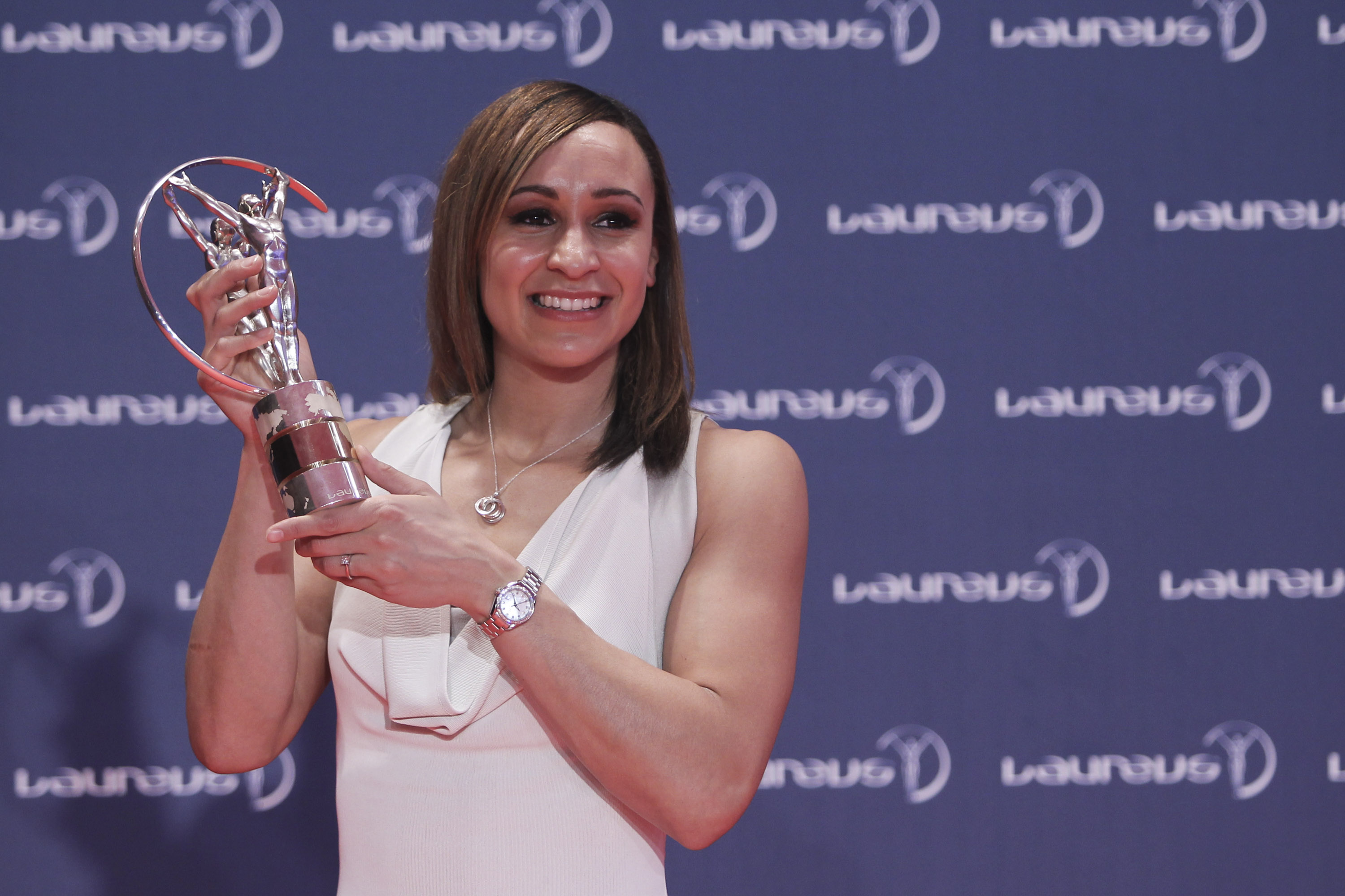 British Heptathlete Jessica Ennis holds up her Laureus World Sportswoman of the Year trophy as she poses for pictures during the Laureus World Sports Awards in Rio de Janeiro, Brazil, Monday, March 11, 2013. (AP Photo)