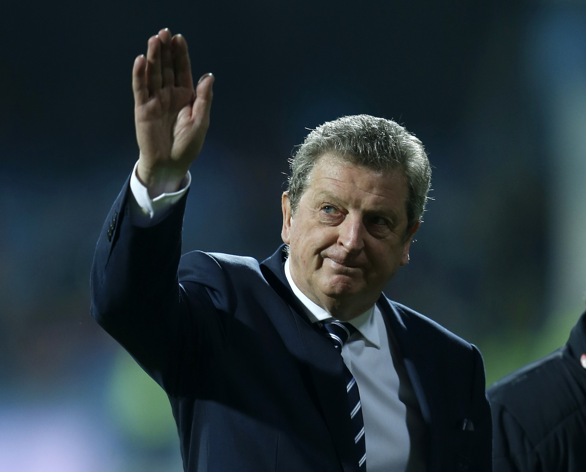 England manager Roy Hodgson salutes the travelling fans on the pitch before their 2014 World Cup qualifying soccer match against Montenegro at the City Stadium in Podgorica