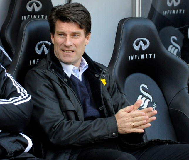 """Swansea City's manager Michael Laudrup watches the match during their English Premier League soccer match against Newcastle United at the Liberty Stadium in Swansea, March 2, 2013. REUTERS/Rebecca Naden (BRITAIN - Tags: SPORT SOCCER) FOR EDITORIAL USE ONLY. NOT FOR SALE FOR MARKETING OR ADVERTISING CAMPAIGNS. NO USE WITH UNAUTHORIZED AUDIO, VIDEO, DATA, FIXTURE LISTS, CLUB/LEAGUE LOGOS OR """"LIVE"""" SERVICES. ONLINE IN-MATCH USE LIMITED TO 45 IMAGES, NO VIDEO EMULATION. NO USE IN BETTING, GAMES OR SINGLE CLUB/LEAGUE/PLAYER PUBLICATIONS"""