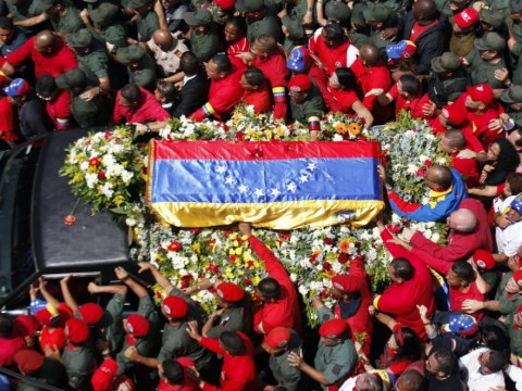 Thousands flood streets as Hugo Chavez's coffin brought out of hospital
