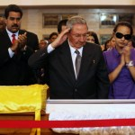 """Cuba's President Raul Castro salutes the body of late Venezuelan President Hugo   Chavez, which is lying in state, as he visits the wake with Chavez's daughter, Rosa Virginia (R), and Venezuela's Vice-President Nicolas Maduro (2nd L) at the military academy in Caracas March 7, 2013, in this picture provided by the Miraflores Palace. Chavez will be embalmed and put on display """"for eternity"""" at a military museum after a state funeral and an extended period of lying in state, acting president Maduro said on Thursday. REUTERS/Miraflores Palace/Handout (VENEZUELA - Tags: POLITICS OBITUARY TPX IMAGES OF THE DAY) ATTENTION EDITORS - THIS IMAGE WAS PROVIDED BY A THIRD PARTY. FOR EDITORIAL USE ONLY. NOT FOR SALE FOR MARKETING OR ADVERTISING CAMPAIGNS. THIS PICTURE WAS PROCESSED BY REUTERS TO ENHANCE QUALITY. AN UNPROCESSED VERSION WILL BE PROVIDED SEPARATELY"""