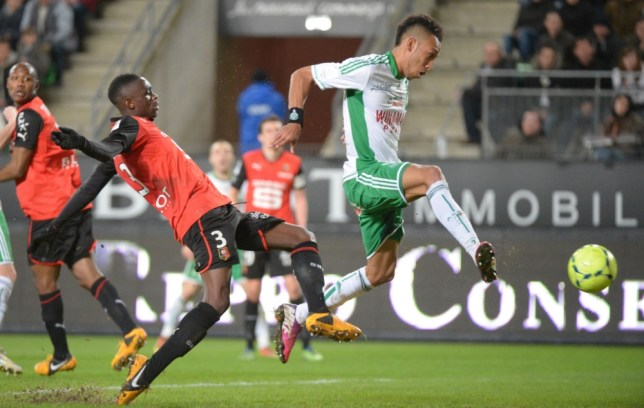 Saint-Etienne's Gabonese forward Pierre-Emerick Aubameyang (R) shoots and scores despite Rennes' French defender Chris Mavinga (L) during the French L1 football match Rennes vs Saint-Etienne on March 8, 2013 at the route de Lorient stadium in Rennes, western France. AFP PHOTO DAMIEN MEYERDAMIEN MEYER/AFP/Getty Images
