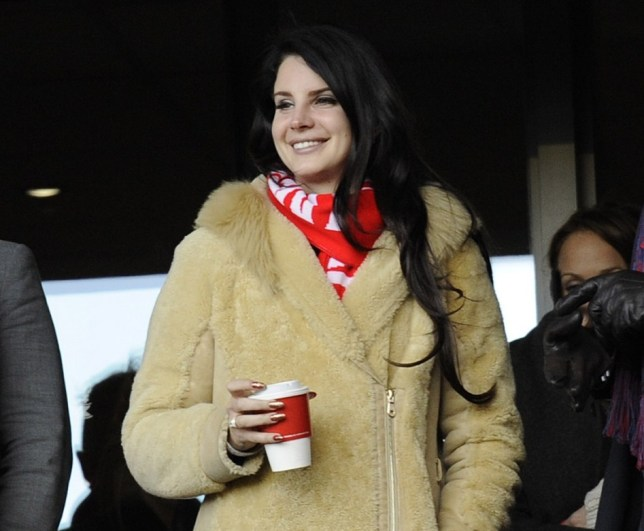 Lana Del Rey pictured at the Liverpool V Spurs premiere League game at Anfield Liverpool. While she was there, one of her guests dropped a hot cup of coffee over one of the fans in the lower sitting area. <P> Pictured: Lana Del Rey <P><B>Ref: SPL498403  100313  </B><BR/> Picture by: Splash News<BR/> </P><P> <B>Splash News and Pictures</B><BR/> Los Angeles: 310-821-2666<BR/> New York: 212-619-2666<BR/> London: 870-934-2666<BR/> photodesk@splashnews.com<BR/> </P>