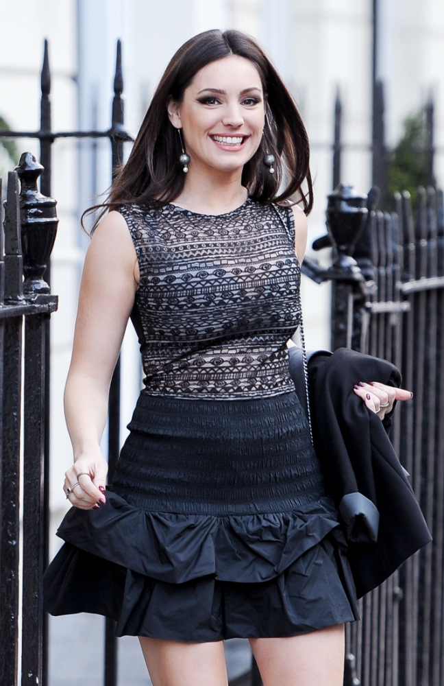 Kelly Brook braves the freezing temperatures as she flashes her bra in sexy sheer top