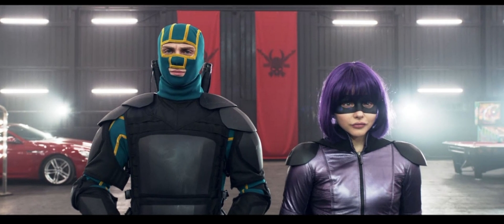 """Aaron Taylor-Johnson and Chloe Grace Moretz return their roles as David """"Dave"""" Lizewski / Kick-Assnand Chloë Grace Moretz as Mindy Macready/ Hit-Girl in 'Kick Ass 2.'nThis time, they will battle mobster's son Chris D'Amico - alias actor 'Superbad' actor Christopher Mintz-Plasse - who is a supervillain known as 'The Mother Fucker.'nFUNNYMAN Jim Carrey stars as former mob enforcer Sal Bertolinni in 'Kick Ass 2.'nBertolinni turns his back on his criminal ways and become psychopathic vigilante 'Colonel Stars and Stripes' in the movie.n"""