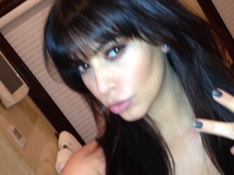 Kim Kardashian follows in sister Kourtney's footsteps as she shows off new blunt fringe