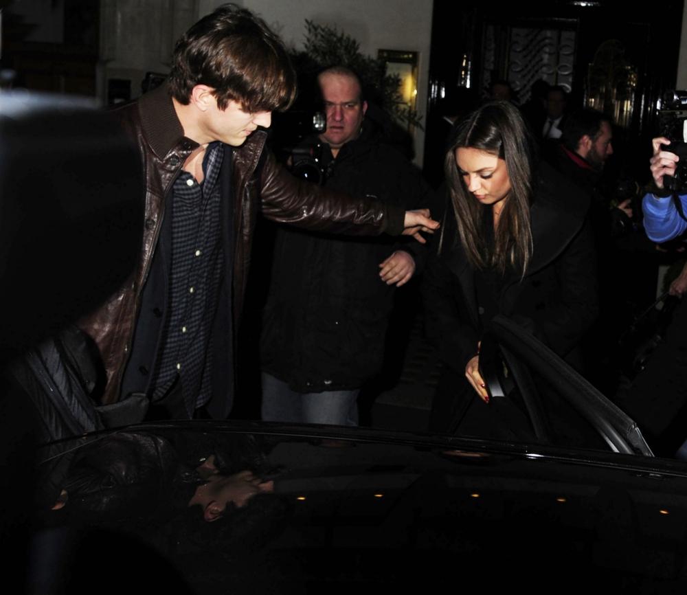 Ashton Kutcher shields Mila Kunis from paparazzi as pair enjoy date night in London