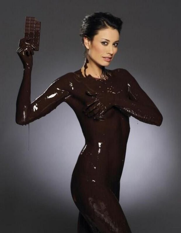 Melanie Sykes gets saucy as she covers her naked body in melted chocolate