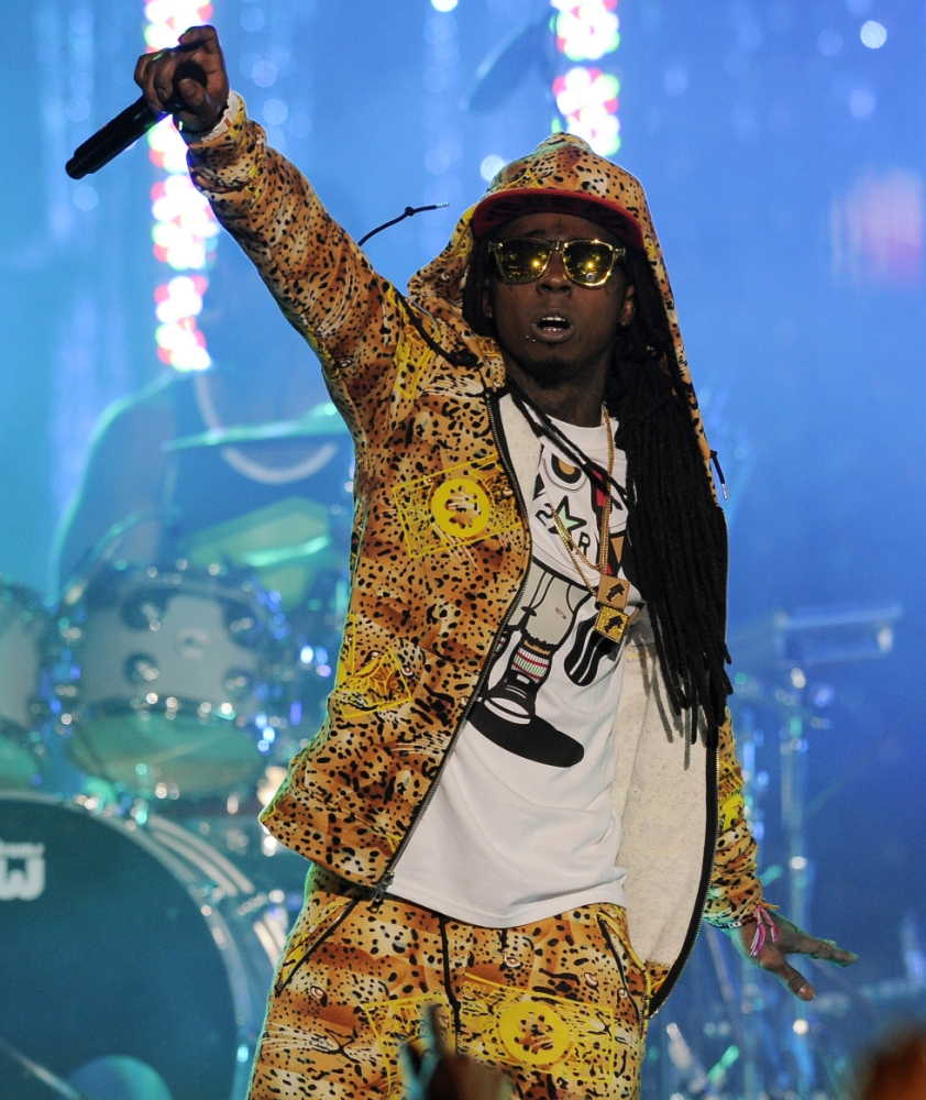 """Lil Wayne performs at the Caesars Entertainment """"Escape To Total Rewards"""" concert, in Los Angeles.  The multiplatinum rapper was hospitalized on Friday night, March 15, 2013, and reps confirmed he was """"recovering."""" A person close to the superstar rapper's camp who asked for anonymity because of the sensitivity of the matter confirmed to The Associated Press that Lil Wayne had a seizure. (AP Photo/Chris Pizzello, File)"""