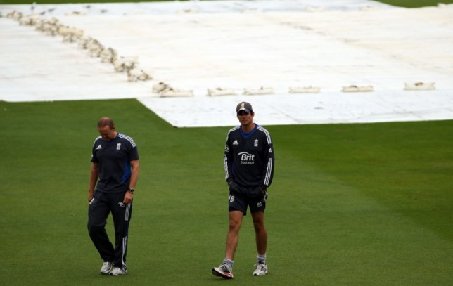 WELLINGTON, NEW ZEALAND - MARCH 18:  England coach Andy Flower (L) and Alastair Cook (R) survey the conditions as rain delays the start of play on day five of the second test match between New Zealand and England at the Basin Reserve on March 18, 2013 in Wellington, New Zealand.  (Photo by Phil Walter/Getty Images)