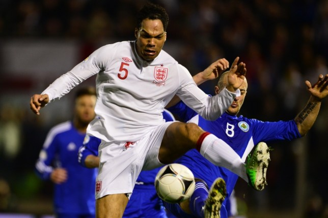 England's Joleon Lescott (front) vies with San Marino's Fabio Bollini during their World Cup 2014 qualifying football match between San Marino and England at Serravalle Stadium in San Marino on March 22, 2013. AFP PHOTO / GIUSEPPE CACACEGIUSEPPE CACACE/AFP/Getty Images