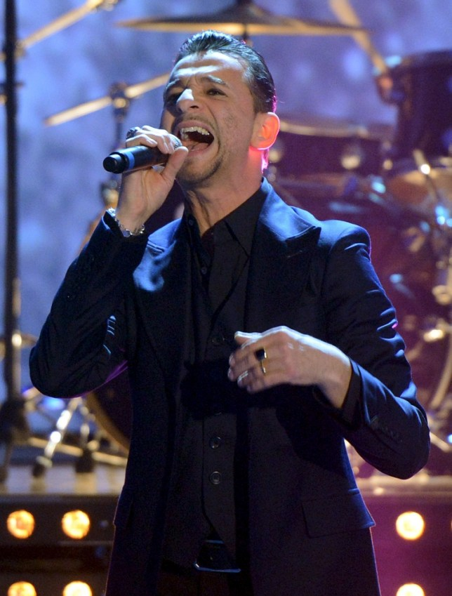 In this picture taken Saturday March 23, 2013, and publicly provided by German TV channel ZDF,  Dave Gahan of British band 'Depeche Mode ' performs  during the German TV game show 'Wetten dass ..?' (Bet it ) in Vienna, Austria. (AP Photo/Sascha Baumann,ZDF) MANDATORY CREDIT