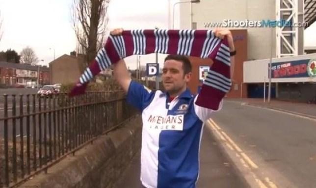 Scarf ace: Burnley fan James McDonough in his Blackburn shirt outside Ewood Park