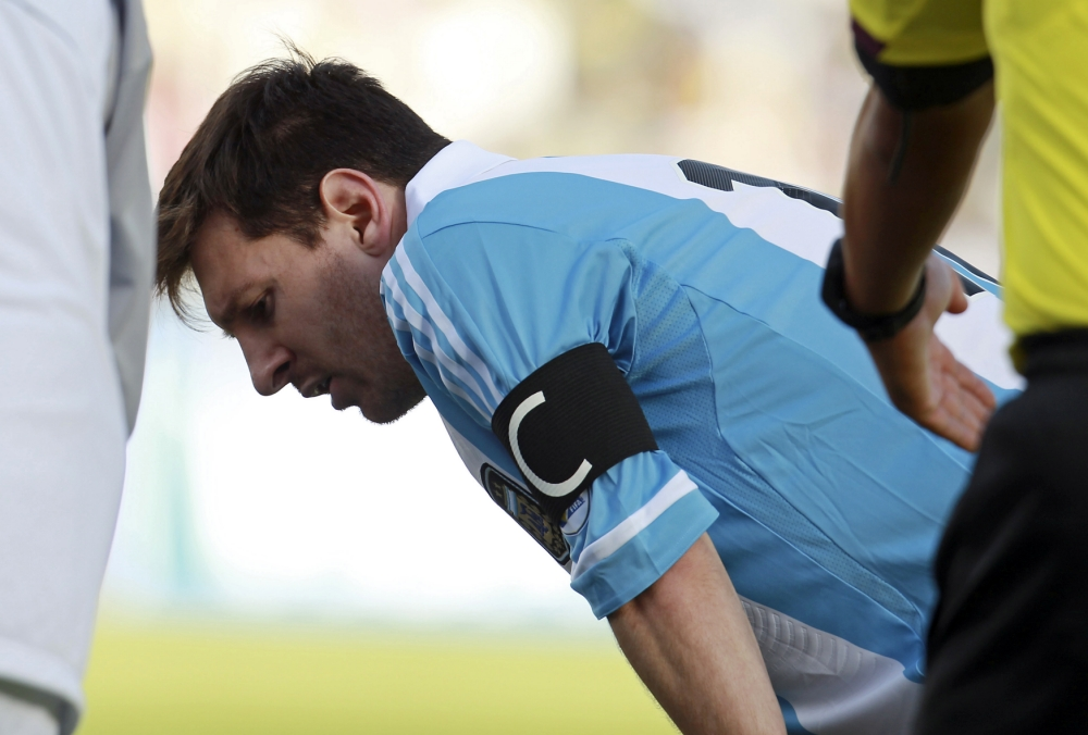 Argentina's Lionel Messi catches his breath during a World Cup 2014 qualifying soccer match against Bolivia in La Paz, Bolivia, Tuesday, March 26, 2013. The match ended tied 1-1. (AP Photo/Juan Karita)