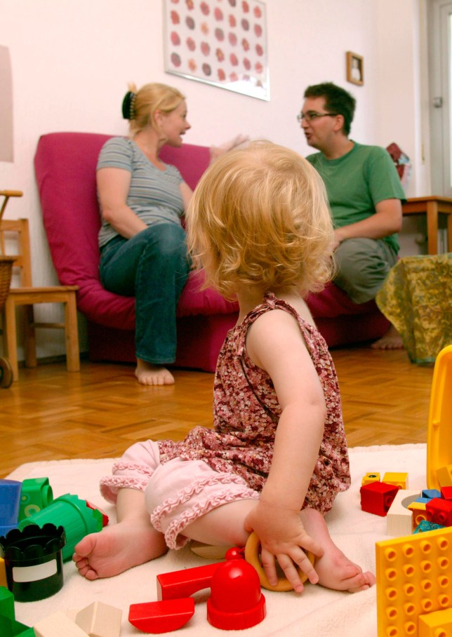 Parents arguing in front of a toddler