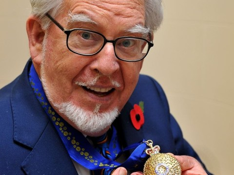 Rolf Harris turns to painting to deal with arrest over sex abuse claims