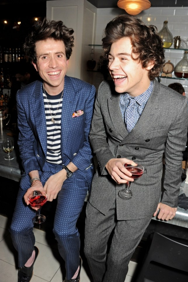 LONDON, ENGLAND - FEBRUARY 19:  (EXCLUSIVE COVERAGE)  Nick Grimshaw (L) and Harry Styles attend as Nick Grimshaw hosts his first annual award season dinner at Hix, in association with Philips Sound, on February 19, 2013 in London, England.  (Photo by Dave M. Benett/Getty Images)