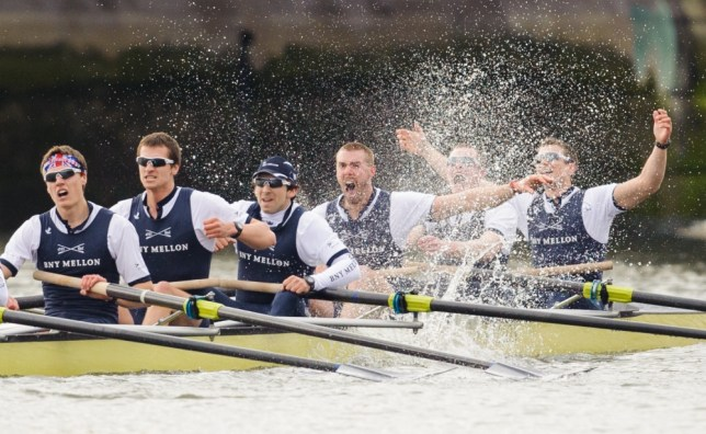 Oxford celebrate victory over Cambridge in the 159th Boat Race on the River Thames, London, Sunday March 31, 2013. (AP Photo/PA,Dominic Lipinski)