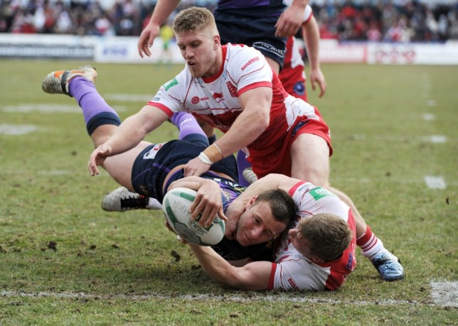 Wigan Warriors' Blake Green goes over to score a try during the Super League match at Craven Park, Hull. PRESS ASSOCIATION Photo. Picture date: Monday April 1, 2013. See PA story RUGBYL Hull KR. Photo credit should read: Anna Gowthorpe/PA Wire. RESTRICTIONS: Editorial use only, no commercial use (including paid for mobile use) without prior permission.