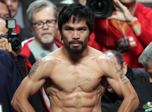 (FILES) This file photo taken on December 7, 2012 shows Manny Pacquiao of the Philippines posing during his weigh-in with Juan Manuel Marquez of Mexico (out of frame) in Las Vegas, Nevada.   Philippine boxing hero Manny Pacquiao plans to fight again in September, with the bout likely to be staged outside the United States to avoid high taxes, his spokeswoman said on April 3, 2013.  AFP PHOTO / FILES / John GURZINSKIJOHN GURZINSKI/AFP/Getty Images