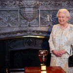 """Queen Elizabeth II receives an honorary Bafta in recognition of a lifetime's support of British film and television - and for being the most """"memorable Bond girl yet"""" during a reception to celebrate the British film industry at Windsor Castle in Windsor on April 4, 2013. The Queen appeared in a film sequence alongside James Bond, played by actor Daniel Craig, during the opening ceremony of the Olympics when she appeared to parachute into the stadium with agent 007. AFP PHOTO/POOL/STEVE PARSONSSteve Parsons/AFP/Getty Images"""