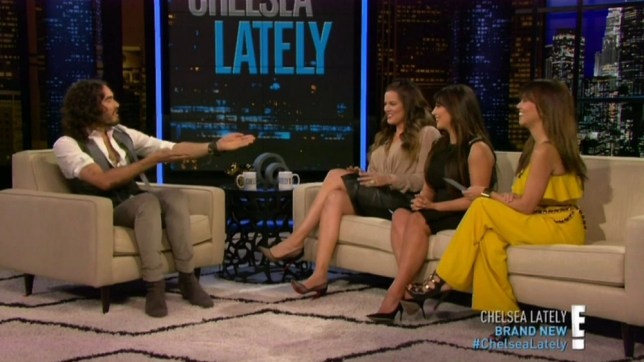 """8 April 2013 - Los Angeles - USA  **** STRICTLY NOT AVAILABLE FOR USA ***  Russell Brand considers a foursome with the Kardashian sisters as they take over hosting duties on Chelsea Lately. The Brit comedian and TV host was the interview guest during the Kardashian takeover of Chelsea Handler's show. KhloÈ Kardashian Odom, Kim Kardashian and Kourtney Kardashian lead the interview, although Brand quickly made the discussion take a turn for the sexual. He joked: """"I'm vulnerable to the concept of a KKK threesome,"""" prompting KhloÈ to turn to Kim and quip: """"Well, I heard pregnant pussy is the best pussy."""" Brand then added: """"I think pregnant women are radiant and beautiful and the idea of lactation is an interesting one."""" The conversation didn't get any cleaner after that, because Brand made it clear that nothing would be more interesting than continuing to talk about: """"A """"limitless, foaming river of milk and orgasm."""" The sisters all giggled while Brand high-fived Khloe. Earlier in the 30 minutes show, the trip had joined mum Kris Jenner on the panel section of the show where Handler is usually joined by three comedians to discuss the day's news headlines. Jenner took Handler's role while the sisters helped her discuss Amanda Bynes recent bizarre behaviour and Handler's own recent naked video with Conan O'Brien. The Kardashians, who had been involved in a mock war of words wtih the Handler over the years, wasted no time in slamming Handler. In their opening monologue they repeatedly bashed her. ìIím sure sheís doing something really important, like drinking,î Kourtney explained as the reason for why Chelsea wasnít hosting. Khloe added: ìOr having sex with somebody that she just met - or both.î In unison the girls ended their monologue with: """"F*** you, Chelsea.î And to get back at Chelsea for her fat jokes about Kim, the Kardashian ladies joked that Kim was wearing one of Chelseaís dresses that she stole from her dressing room. Pregnant Kim snarked: ì"""