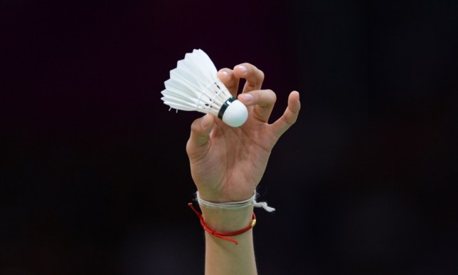 China's seed number one Wang Yihan's hand holds the shuttlecock during the women's singles badminton match against Michele Li of Canada at the London 2012 Olympic Games in London on July 30, 2012. Wang won the match 21-8, 21-6. AFP PHOTO / ADEK BERRY        (Photo credit should read ADEK BERRY/AFP/GettyImages)