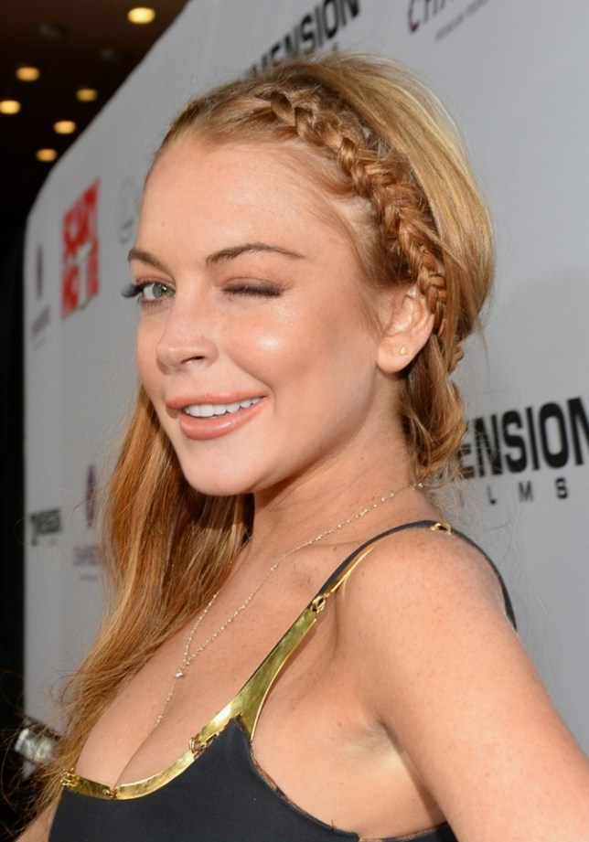 "HOLLYWOOD, CA - APRIL 11:  Actress Lindsay Lohan arrives for the premiere of Dimension Films' ""Scary Movie 5"" at ArcLight Cinemas Cinerama Dome on April 11, 2013 in Hollywood, California.  (Photo by Michael Buckner/Getty Images)"