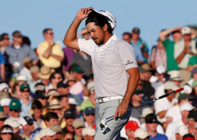 Jason Day of Australia takes off his hat after sinking a bogey putt on the 18th green during third round play in the 2013 Masters golf tournament at the Augusta National Golf Club in Augusta, Georgia, April 13, 2013.  REUTERS/Mike Segar (UNITED STATES  - Tags: SPORT GOLF)