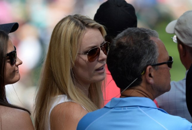 Lindsey Vonn watches Tiger Woods teeing off on 6th hole during the third round of the 77th Masters golf tournament at Augusta National Golf Club on April 13, 2013 in Augusta, Georgia. AFP PHOTO/Jewel SamadJEWEL SAMAD/AFP/Getty Images