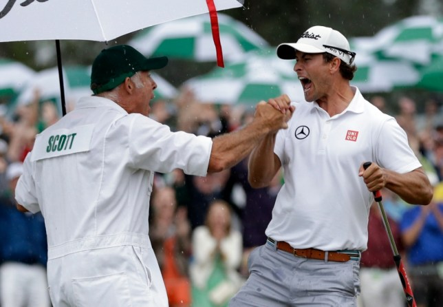 Adam Scott, of Australia, celebrates with his caddie Steve Williams celebrates after a birdie putt on the 18th green during the fourth round of the Masters golf tournament Sunday, April 14, 2013, in Augusta, Ga. (AP Photo/David J. Phillip)