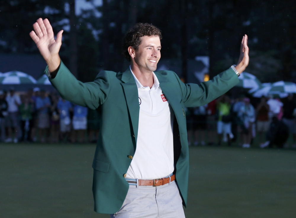 Adam Scott of Australia celebrates with his green jacket after winning the 2013 Masters golf tournament at the Augusta National Golf Club in Augusta, Georgia, April 14, 2013.   REUTERS/Phil Noble (UNITED STATES - Tags: SPORT GOLF TPX IMAGES OF THE DAY)