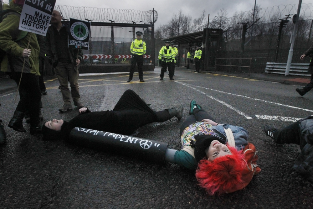 Anti-Trident protesters chain themselves to gates at Faslane naval base