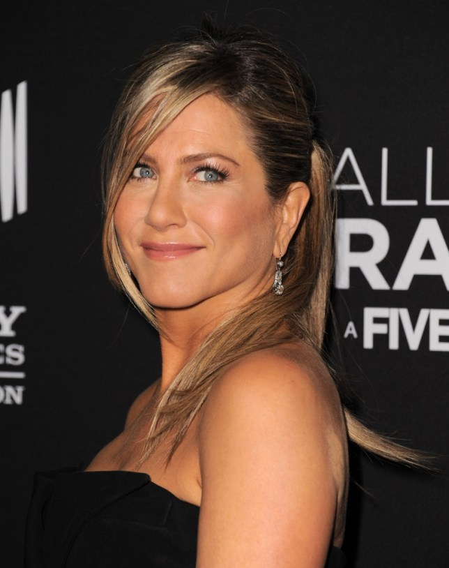 """Jennifer Aniston arrives at the world premiere of """"Call Me Crazy: A Five Film"""" at the Pacific Design Center on Tuesday, April 16, 2013 in Los Angeles. (Photo by Jordan Strauss/Invision/AP)"""