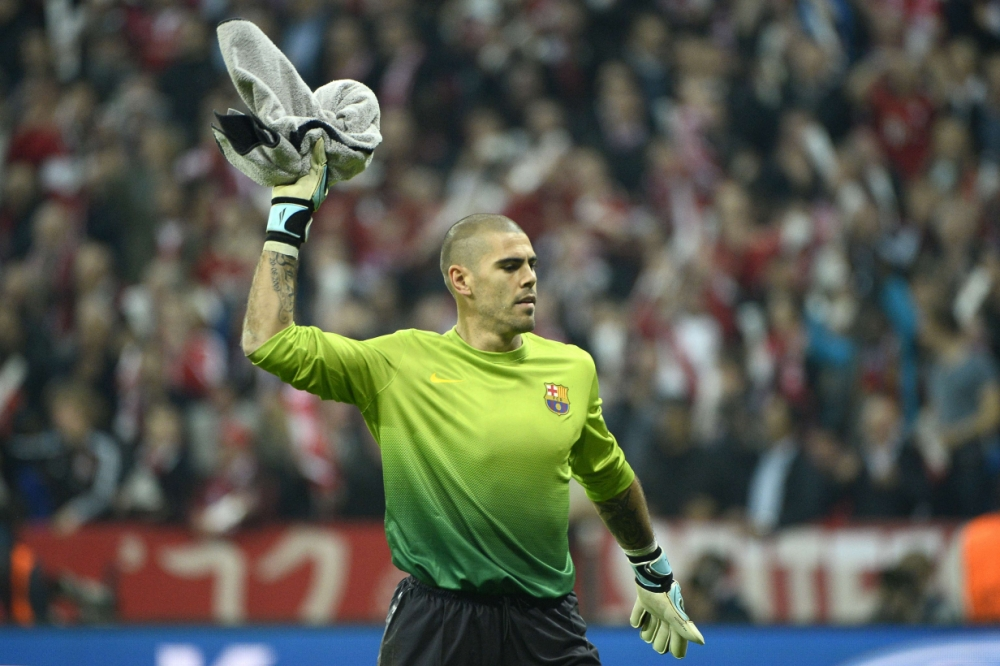 Barcelona's goalkeeper Victor Valdes throws his towel as he reacts during the UEFA champions league semi final first leg football match FC Bayern Muenchen vs FC Barcelona on April 23, 2013 in Munich, southern Germany.   AFP PHOTO / PIERRE-PHILIPPE MARCOUPIERRE-PHILIPPE MARCOU/AFP/Getty Images