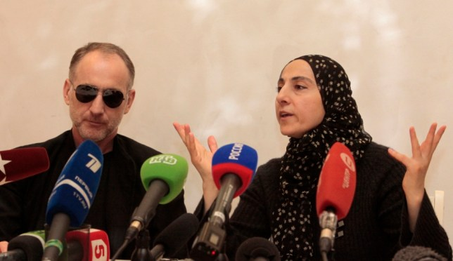 The parents of the two Boston bombing suspects, Zubeidat Tsarnaeva, with the suspects' father Anzor Tsarnaev, left, speaks at a news conference in Makhachkala, the southern Russian province of Dagestan, Thursday, April 25, 2013. The father of the two Boston bombing suspects said Thursday that he is leaving Russia for the United States in the next day or two, but their mother said she was still thinking it over. (AP Photo/Musa Sadulayev)
