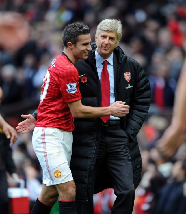 MANCHESTER, ENGLAND - NOVEMBER 03:  Arsene Wenger the Manager of Arsenal speaks to Robin van Persie of Manchester United as the teams come off for half time during the Barclays Premier League match between Manchester United and Arsenal at Old Trafford on November 3, 2012 in Manchester, England.  (Photo by David Price/Arsenal FC via Getty Images,)