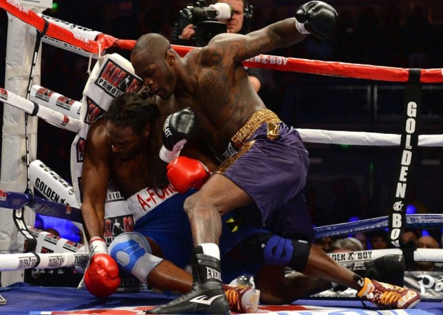 Audley Harrison of Great Britain (L) is knocked to the floor by Deontay Wilder of USA during their International Heavyweight Contest at the Motorpoint Arena in Sheffield, England on April 27, 2013. AFP PHOTO/ANDREW YATESANDREW YATES/AFP/Getty Images