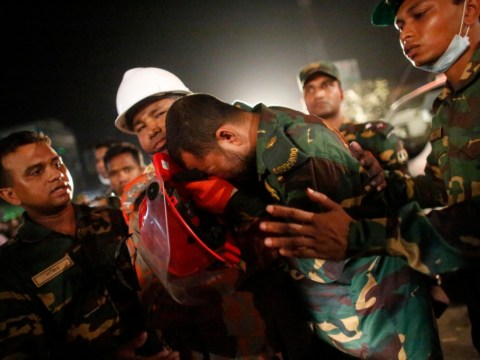 Bangladesh factory collapse: Woman killed by fire as rescuers attempt to pull her from the rubble