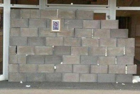 Furious Rapid Vienna fans build a brick wall in front of their club's headquarters