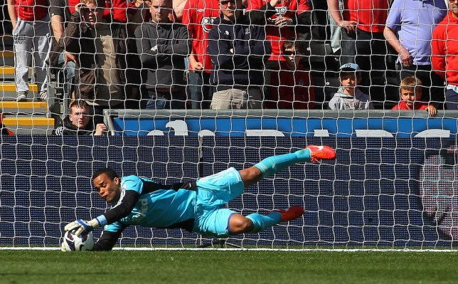 Swansea City's Dutch goalkeeper Michel Vorm saves on the line during the English Premier League football match between Swansea City and Southampton at Liberty Stadium in Swansea, south Wales, on April 20, 2013. AFP/Getty Images