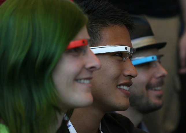 SAN FRANCISCO, CA - MAY 17:  Attendees wear Google Glass while posing for a group photo during the Google I/O developer conference on May 17, 2013 in San Francisco, California. Eight members of the Congressional Bi-Partisan Privacy Caucus sent a letter to Google co-founder and CEO Larry Page seeking answers to privacy questions and concerns surrounding Google's   photo and video-equipped glasses called 'Google Glass'. The panel wants to know if the high tech eyeware could infringe on the privacy of Americans. Google has been asked to respond to a series of questions by June 14. Getty Images