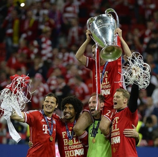Top boys: Daniel van Buyten, Dante, Tom Starke, Philipp Lahm and Manuel Neuer with the trophy (Picture: AFP/Getty Images)