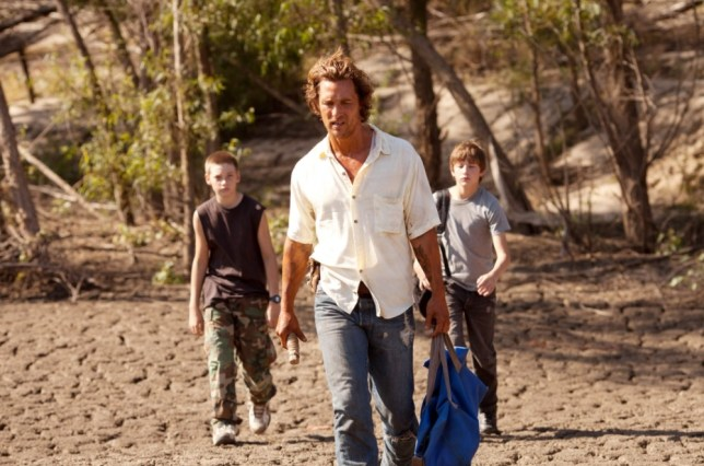 In Mud, McConaughey plays a fugitive who befriends teens Jacob Lofland and Tye Sheridan (Picture: Rex)