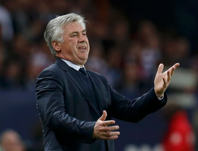 Paris Saint-Germain's coach Carlo Ancelotti reacts during their French Ligue 1 soccer match against Valenciennes at the Parc des Princes stadium in Paris May 5, 2013.  REUTERS/Gonzalo Fuentes (FRANCE  - Tags: SPORT SOCCER)